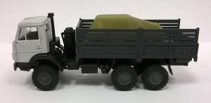 Модель КАМАЗ 4310 ( 6*6 ) с одинарной кабиной,борт высокий с грузом.Пр-во MINITANKS.Масштаб 1:87 (НО).