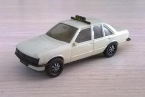 Модель автомобиля OPEL RECORD Taxi.Пр-во HERPA.Масштаб НО (1:87).