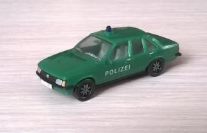 Модель автомобиля Opel Record Berlina 2.0E POLIZEI.Пр-во HERPA.Масштаб НО (1:87).