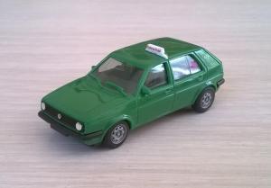 Модель автомобиля VW Golf Fahrschule.Пр-во HERPA.Масштаб НО (1:87).