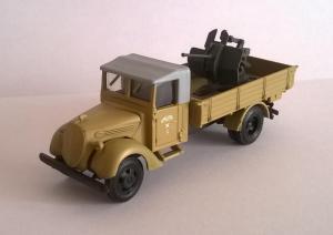 Модель Ford 3000T Erzatz бортовой с зениткой 20мм.Пр-во AMA.Арт.184.Масштаб НО (1:87).